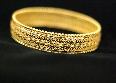 Picture of Gold Ring against Black Background