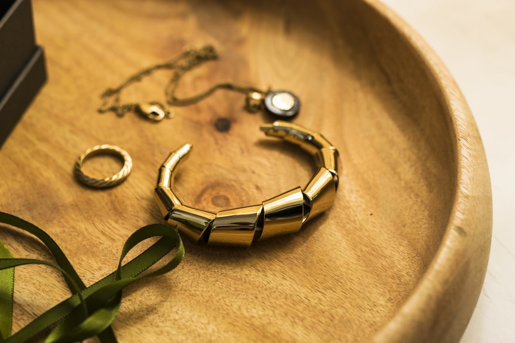 Jewelry in a wooden bowl