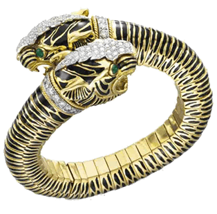 Gold bejeweled two-headed leopard ring on white background